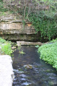 A stream flowing from a cave