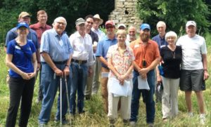 Many Ozark Regional Land Trust employees and members in a group photo on a conservation easement property