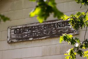 """An old sign saying """"Oak Hill Grange est. 1956"""""""
