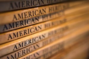 """A stack of old """"American eritage books"""" from the Oak Hill Grange Library"""