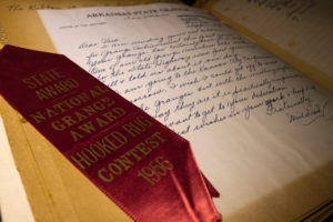 An old record book with an award inside